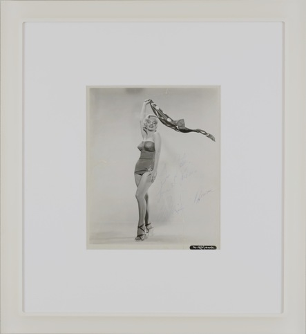 """Acrylic + Acrylic A perfect match for her cool acrylic shoes -  a cool acrylic frame.  1953 black and white photo from the  movie """"How to Marry A Millionaire"""", Marilyn Monroe as a pin-up girl. Signature with dedication: """"To Peter, Love and Kisses, Marilyn Monroe""""."""